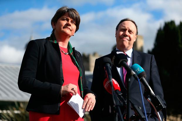 DUP leader Arlene Foster and deputy leader Nigel Dodds speak to the media, on the grounds of Stormont Castle, after the UK government warned that failure to form a new powersharing executive in Northern Ireland by early May will force another snap election or a return to direct rule from London. PA