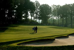 LOUISVILLE, KY - AUGUST 07:  Hideki Matsuyama of Japan walks up the tenth fairway with his caddie Daisuke Shindo during the first round of the 96th PGA Championship at Valhalla Golf Club on August 7, 2014 in Louisville, Kentucky.  (Photo by Andrew Redington/Getty Images)
