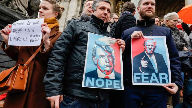 People protest against US President Donald Trump's executive immigration ban on January 30, 2017 in Brussels.  US President Donald Trump faced fresh protests on January 30 over his ban on travelers from seven Muslim countries entering the United States, a backlash that poses an enormous test for his administration. / AFP PHOTO / Belga / THIERRY ROGE / Belgium OUTTHIERRY ROGE/AFP/Getty Images