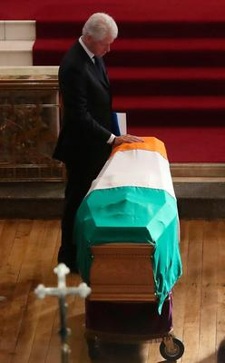 Martin McGuinness funeral...Former US President Bill Clinton touches the coffin during the funeral of Northern Ireland's former deputy first minister and ex-IRA commander Martin McGuinness at St Columba's Church Long Tower, in Londonderry. PRESS ASSOCIATION Photo. Picture date: Thursday March 23, 2017. See PA story FUNERAL McGuinness. Photo credit should read: Niall Carson/PA Wire...A