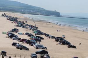 A busy warm day with cars at Portstewart Strand Beach. PICTURE MARK JAMIESON.