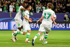 Wolfsburg's Swiss defender Ricardo Rodriguez (C) reacts after scoring a penalty during the UEFA Champions League quarter-final, first-leg football match between VfL Wolfsburg and Real Madrid on April 6, 2016 in Wolfsburg, northern Germany.  / AFP PHOTO / John MACDOUGALLJOHN MACDOUGALL/AFP/Getty Images