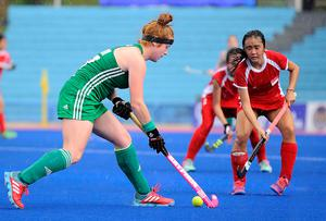 Forward thinking: Zoe Wilson stretches the Singapore defence