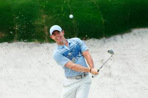 So near: Rory McIlroy plays out of a bunker at Seminole last night