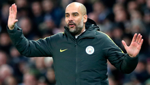 Holding his hands up: Pep Guardiola has admitted he was wrong to spark retirement rumours. Photo: Martin Rickett/PA