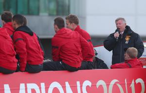 MANCHESTER, ENGLAND - MAY 13:  Sir Alex Ferguson adresses the crowd on the open topped bus outside Old Trafford during the Manchester United Premier League winners parade on May 13, 2013 in Manchester, England.  (Photo by Alex Livesey/Getty Images)
