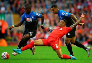 LIVERPOOL, ENGLAND - AUGUST 17:  Joshua King (R) and Max Gradel of Bournemouth (L) battle with Nathaniel Clyne of Liverpool (C) during the Barclays Premier League match between Liverpool and A.F.C. Bournemouth at Anfield on August 17, 2015 in Liverpool, United Kingdom.  (Photo by Alex Livesey/Getty Images)