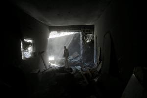 A member of the Shabat family inspects damages upon returning to the family house, destroyed by Israeli strikes in the town of Beit Hanoun, northern Gaza Strip, Tuesday, Aug. 5, 2014.  (AP Photo/Lefteris Pitarakis)