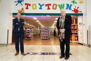 Pictured outside the newly opened Abbey Centre store in Belfast is left Aaron McAuley, business manager, Bank of Ireland UK with owner and managing director of Toytown, Alan Simpson