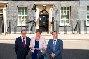 DUP leader Arlene Foster, DUP deputy leader Nigel Dodds (left) and MP Sir Jeffrey Donaldson outside 10 Downing Street in London after the party agreed a deal to support the minority Conservative government Dominic Lipinski/PA Wire