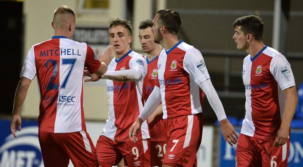 Linfield's Joel Cooper scores to help the Blues into the League Cup quarter-finals.