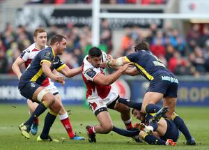 10 December 2016 - Picture by Darren Kidd / Press Eye.    Champions Cup, Ulster v Clermont at the KIngspan Stadium, Belfast.  Ulster's CharlesPiutau is tackled by Clermont's Camille Lopez, Rémi Lamerat and Alexandre Lapandry