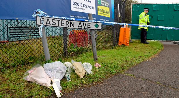 Floral tributes at the Waterglade Industrial Park in Grays, Essex, after 39 bodies were found inside a lorry on the industrial estate. Stefan Rousseau/PA Wire