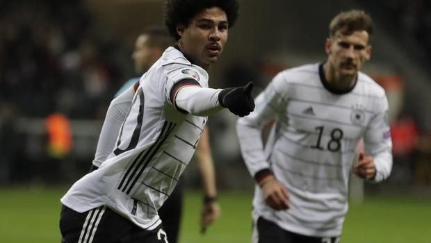 Serge Gnabry, left, celebrates one of his three goals (Michael Probst/AP).