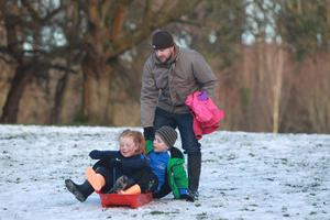 10/12/17 PACEMAKER PRESS  People make the best of the snow in the grounds of Stormont. Brian Buckley with his two children Finn and Jenna take their sled out. PICTURE MATT BOHILL PACEMAKER PRESS