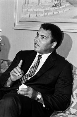 """This file photo taken on October 05, 1986 shows Former heavyweight world boxing champion Muhammad Ali speaking during a press conference at the Marriott hotel in Cairo, Egypt. Boxing icon Muhammad Ali died on Friday, June 3, a family spokesman said in a statement. """"After a 32-year battle with Parkinsons disease, Muhammad Ali has passed away at the age of 74,"""" spokesman Bob Gunnell said. / AFP PHOTO / MIKE NELSONMIKE NELSON/AFP/Getty Images"""