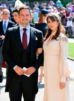 Meghan Markle's friend, US actor Patrick J. Adams and wife Troian Bellisario arrive for the wedding ceremony of Britain's Prince Harry, Duke of Sussex and US actress Meghan Markle at St George's Chapel, Windsor Castle, in Windsor, on May 19, 2018. / AFP PHOTO / POOL / Ian WESTIAN WEST/AFP/Getty Images