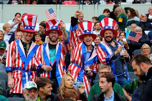 USA fans show their support in the stands before the World Cup match at the Olympic Stadium, London. PRESS ASSOCIATION Photo. Picture date: Wednesday October 7, 2015. See PA story RUGBYU South Africa. Photo credit should read: Gareth Fuller/PA Wire. RESTRICTIONS: Editorial use only. Strictly no commercial use or association without RWCL permission. Still image use only. Use implies acceptance of Section 6 of RWC 2015 T&Cs at: http://bit.ly/1MPElTL Call +44 (0)1158 447447 for further info.