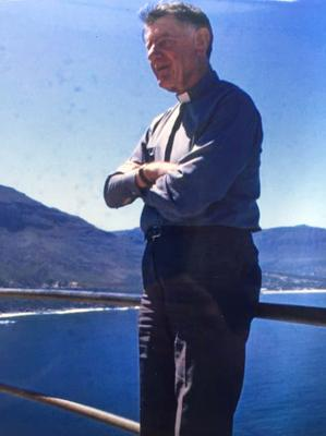 It has been suggested that Northern Ireland born priest Desmond Curran (pictured in South Africa) knew the identity of his sister's killer.