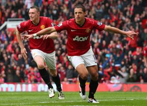 MANCHESTER, ENGLAND - MAY 12:  Javier Hernandez of Manchester United celebrates after scoring the opening goal during the Barclays Premier League match between Manchester United and Swansea City at Old Trafford on May 12, 2013 in Manchester, England.  (Photo by Alex Livesey/Getty Images)