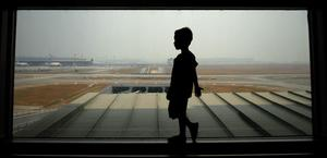 KUALA LUMPUR, MALAYSIA - MARCH 12:  A boy waits for his family members arrival at Kuala Lumpur International Airport on March 12, 2014 in Kuala Lumpur, Malaysia. (Photo by Rahman Roslan/Getty Images)