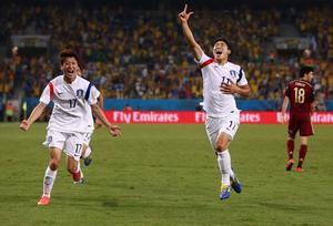 CUIABA, BRAZIL - JUNE 17: Lee Keun-Ho of South Korea (R) celebrates scoring his team's first goal during the 2014 FIFA World Cup Brazil Group H match between Russia and South Korea at Arena Pantanal on June 17, 2014 in Cuiaba, Brazil.  (Photo by Warren Little/Getty Images)