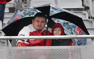 @Press Eye Ltd Northern Ireland- 15th   May   2014 Mandatory Credit -Brian Little/Presseye  Motorcycle fans shelter from the showers during the Vauxhall International 2014  North West 200.  Picture by  Brian Little/Presseye