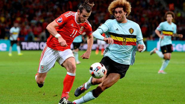 Wales' Gareth Bale (left) and Belgium's Marouane Fellaini battle for the ball during the UEFA Euro 2016, quarter final match at the Stade Pierre Mauroy, Lille. PRESS ASSOCIATION Photo. Picture date: Friday July 1 2016. See PA story SOCCER Wales. Photo credit should read: Joe Giddens/PA Wire. RESTRICTIONS: Use subject to restrictions. Editorial use only. Book and magazine sales permitted providing not solely devoted to any one team/player/match. No commercial use. Call +44 (0)1158 447447 for further information.