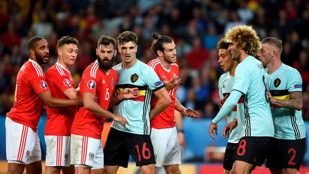 Wales' players and Belgium players tussle for position during a free kick during the UEFA Euro 2016, quarter final match at the Stade Pierre Mauroy, Lille. PRESS ASSOCIATION Photo. Picture date: Friday July 1 2016. See PA story SOCCER Wales. Photo credit should read: Joe Giddens/PA Wire. RESTRICTIONS: Use subject to restrictions. Editorial use only. Book and magazine sales permitted providing not solely devoted to any one team/player/match. No commercial use. Call +44 (0)1158 447447 for further information.