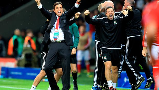 Wales manager Chris Coleman (left) and fitness coach Ryland Morgans (right) celebrate after Hal Robson-Kanu (not in picture) scores his side's second goal of the game  during the UEFA Euro 2016, quarter final match at the Stade Pierre Mauroy, Lille. PRESS ASSOCIATION Photo. Picture date: Friday July 1 2016. See PA story SOCCER Wales. Photo credit should read: Mike Egerton/PA Wire. RESTRICTIONS: Use subject to restrictions. Editorial use only. Book and magazine sales permitted providing not solely devoted to any one team/player/match. No commercial use. Call +44 (0)1158 447447 for further information.
