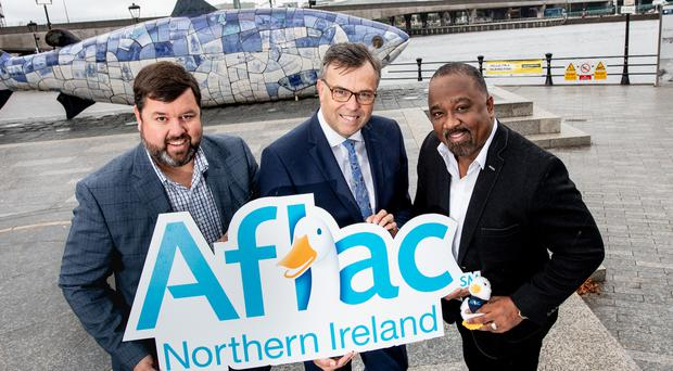 Keith Farley, managing director of Aflac Northern Ireland, Alastair Hamilton, CEO, Invest Northern Ireland and Virgil Miller, executive vice president and chief operating officer of Aflac US