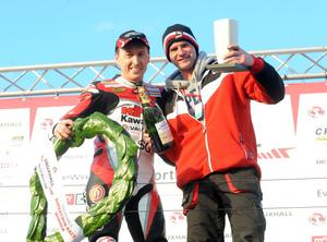 PACEMAKER BELFAST, 16-05-13: Jeremy McWilliams celebrates winning the Supertwins race at the Vauxhall International North West 200 this evening with team boss Ryan Farquhar. PICTURE BY STEPHEN DAVISON