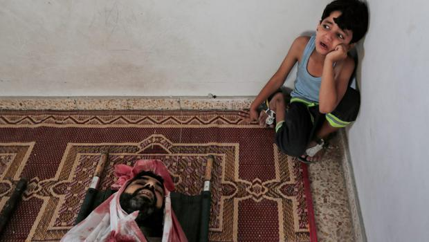 A Palestinian boy weeps next to the body of Bassem al-Najar, killed in an Israeli strike, at the family house during the funeral in Jebaliya refugee camp, northern Gaza Strip, Wednesday, July 30, 2014. (AP Photo/Lefteris Pitarakis)