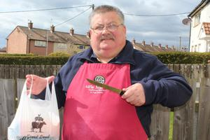 Killyleagh councillor Billy Walker dons a butcher's apron after his big hearted gesture to pensioners.