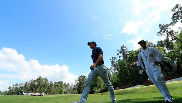 Rory McIlroy of Northern Ireland walks to the 14th tee during the first round of the Masters at Augusta National Golf Club on April 11, 2019 in Augusta, Georgia. (Photo by Mike Ehrmann/Getty Images)