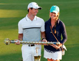 Rory McIlroy celebrates with Erica Stoll after winning the DP World Tour Golf Championship in Dubai earlier this month
