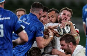 Ulster's Stuart McCloskey is tackled by Jamison Gibson-Park