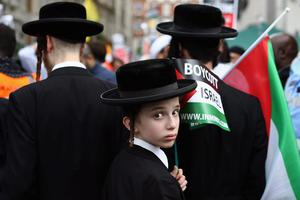 Pro Palestinian demonstrators march through central London on July 25, 2014 in London, England.  (Photo by Dan Kitwood/Getty Images)