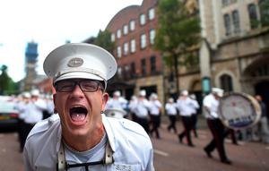 BELFAST, NORTHERN IRELAND - JULY 12: An Orange bandsman screams into the camera as he takes part in the annual Orange march on July 12, 2016 in Belfast, Northern Ireland. The Orange marches and demonstrations celebrate the Battle of the Boyne in 1690 when the Protestant King William of Orange defeated the Catholic King James II on the banks of the river Boyne. (Photo by Charles McQuillan/Getty Images)