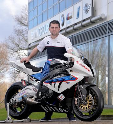 Michael Dunlop pictured with the BMW S1000RR Superbike that he will race in 2014
