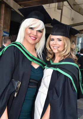 Ulster University Graduations-Waterfront Hall 03-07-15 Natasha Hutchins graduated in Computer Science and Michaela Cromie graduated in ICT Photo by Simon Graham/Harrison Photography