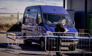 Police at the scene of an attempted cash van robbery at Asda on Kennedy Way in west Belfast on April 11th 2020 (Photo by Kevin Scott for Belfast Telegraph)