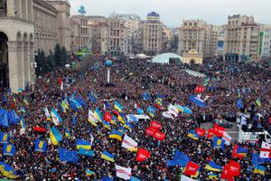 Demonstrators gather during a rally in downtown Kiev, Ukraine, on Sunday, Dec. 1, 2013. As many as 100,000 demonstrators chased away police to rally in the center of Ukraine's capital on Sunday, defying a government ban on protests on Independence Square, in the biggest show of anger over the president's refusal to sign an agreement with the European Union. (AP Photo/Sergei Grits)