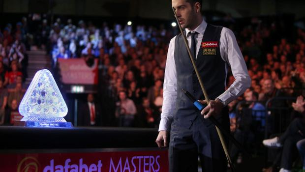 Mark Selby walks out for the start of the match during the 2014 Dafabet Masters at Alexandra Palace, London. PRESS ASSOCIATION Photo. Picture date: Sunday January 19, 2014. See PA story SNOOKER Masters. Photo credit should read: John Walton/PA Wire