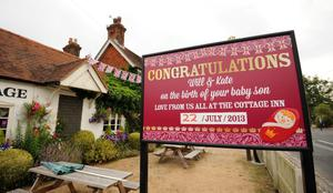A sign congratulating The Duke and Duchess of Cambridge on the birth of their son is displayed at the Cottage Inn in Bucklebury, the family home of the Middletons. Andrew Matthews/PA Wire