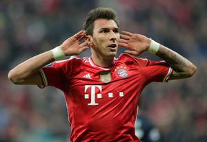 Bayern's Mario Mandzukic celebrates after scoring the equaliser during the Champions League quarterfinal second leg soccer match between Bayern Munich and Manchester United in the Allianz Arena in Munich, Germany, Wednesday, April 9, 2014. (AP Photo/Matthias Schrader)