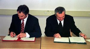 Tony Blair and Bertie Ahern sign the peace agreement in 1998 (Dan Chung/PA)