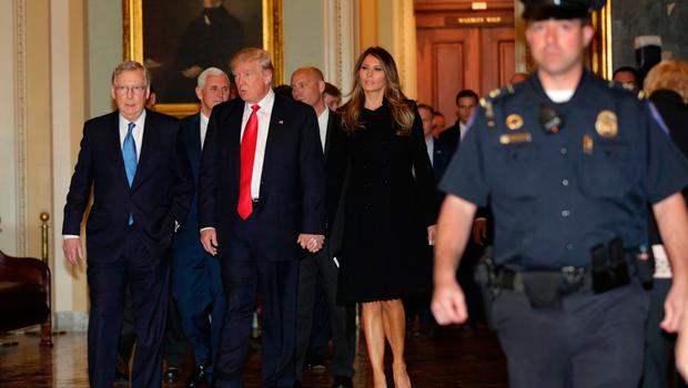 US President-elect Donald Trump (C) walks with his wife Melania Trump and Vice President-Elect Pence (2nd L) before a meeting with Senate Majority Leader Mitch McConnell(L) R-KY on Capitol Hill in Washington,DC on November 10, 2016. / AFP PHOTO / YURI GRIPASYURI GRIPAS/AFP/Getty Images