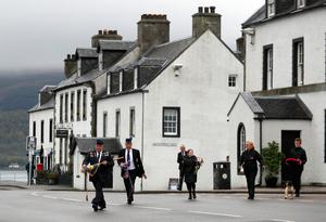 Members from the Inveraray Royal British Legion head to the war memorial in Inveraray, to mark the 75th anniversary of VE Day. PA Photo. Picture date: Friday May 8, 2020. See PA story MEMORIAL VE. Photo credit should read: Andrew Milligan/PA Wire