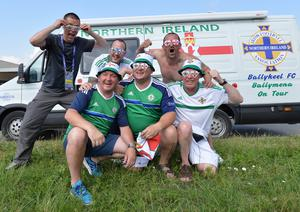 A Local meets with  Northern Ireland Fans Ian Thompson, George McFall , Russell Bridgett , Darren McDonald and Eddie McCullough   from Ballymena travel threw St Georges de Reneines  in a camper van, on the way to Nice as N Ireland face Poland in their opening match on Sunday. Pic Colm Lenaghan/Pacemaker